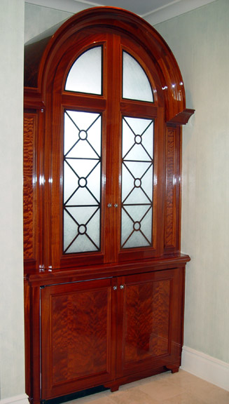 Above U0026 Below: Pommele Sapele Cabinet With Wrought Iron U0026 DecoGlass Doors.  Interior Features Starphire Glass Shelves And Access Activated LED Lighting.